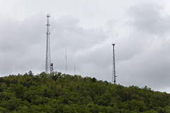 Various sized towers atop a lush green mountain. Royalty Free Stock Photography