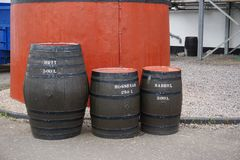Various sizes of whisky barrels in Scotland. The barrels range in volume from 200 to 500 liters Stock Photography