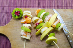 Various skewered fruit on a cutting board Stock Photos