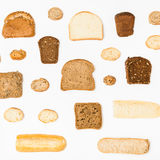 Various sliced bread loaves on white stock photos