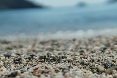 Various small pebbles stones on the beach.. Various small pebbles stones on the beach. selective focus Stock Image