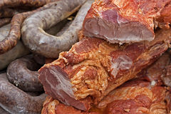 Various smoked meat specialties Stock Photography
