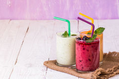 Various smoothies in glasses Royalty Free Stock Images