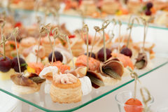 Various snacks on banquet table Royalty Free Stock Images