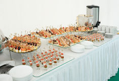 Various snacks on banquet table Stock Photos