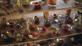 Various snacks on a buffet table at the event, the camera moves smoothly stock footage