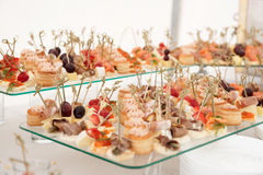 Various snacks in plate on banquet table Royalty Free Stock Image