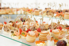 Various snacks on platter Stock Images