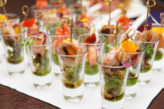 Various snacks in shot glasses Stock Images