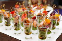 Various snacks in shot glasses Royalty Free Stock Image