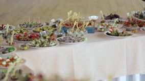 Various snacks on a table event, the camera on the move goes around the table stock video
