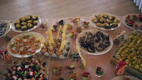Various snacks at the wedding table, the camera moves smoothly stock footage