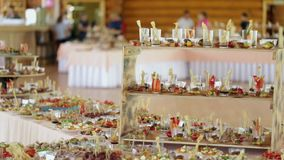 Various snacks at the wedding table, the camera moves smoothly. Guests gather for a party stock video