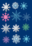 Various snowflake designs on a dark blue background stock images