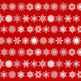 Various Snowflakes Pattern on Red Background Stock Images