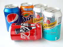 Various soda drinks in aluminum cans, fanta, coca-cola, pepsi and schweppes Royalty Free Stock Image