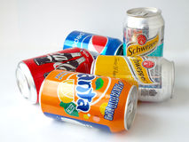 Various soda drinks in aluminum cans, fanta, coca-cola, pepsi and schweppes Royalty Free Stock Photography