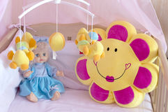 Various soft toys in the cot with orange linen Royalty Free Stock Photo