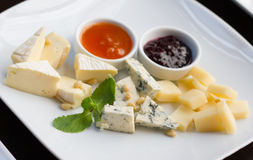 Various sorts of cheese Stock Photos