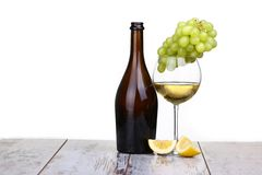 Various sorts of fruits. Grapes and glass of the white wine Royalty Free Stock Images