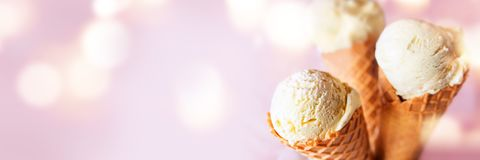 Various sorts ice cream cones. On a pink panorama background with bokeh effects Royalty Free Stock Images