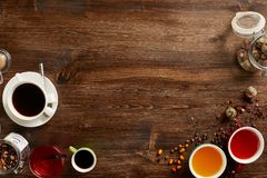 Various sorts of tea and coffee with copyspace. Overhead view of various sorts of tea and coffee. Flavoured with Assorted Herbs and coffee beans on a rustic wood stock image