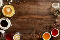 Various sorts of tea and coffee with copyspace. Overhead view of various sorts of tea and coffee. Flavoured with Assorted Herbs and coffee beans on a rustic wood stock photo