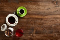 Various sorts of tea and coffee. Overhead view of various sorts of tea and coffee. Flavoured with Assorted Herbs and coffee beans on a rustic wood board stock image