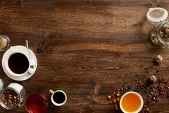 Various sorts of tea and coffee. Overhead view of various sorts of tea and coffee. Flavoured with Assorted Herbs and coffee beans on a rustic wood board stock photography