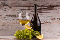 Various sorts of wine. Grapes and two glasses of the white wine Royalty Free Stock Photography