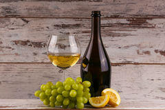 Various sorts of wine, grapes and two glasses of the white wine Stock Photography