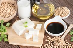 Various soy products with soy sauce, tofu, oil, soy bean and soy. Milk Stock Photography