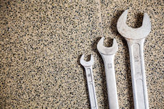 Various Spanners On Floor Royalty Free Stock Photos