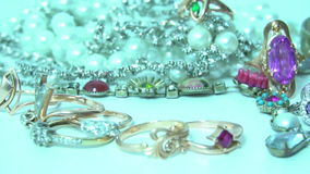 Various sparkling jewelry. Various sparkling beautiful jewelry turning around stock video