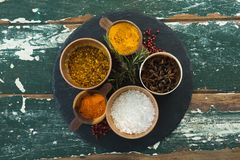 Various spices arranged in board Stock Image