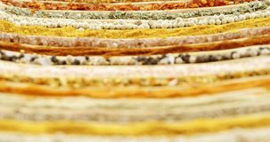 Various spices arranged in a row 4k. Close-up of various spices arranged in row 4k stock video