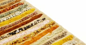 Various spices arranged in tray 4k. Close-up of various spices arranged in tray 4k stock video