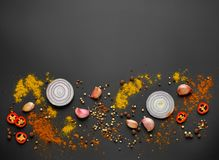 Various spices on black background. Top view Stock Photos