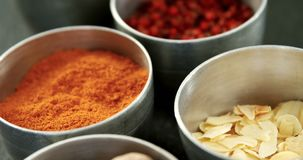 Various spices in bowl 4k. Close-up of various spices in bowl on black background 4k stock footage