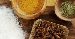 Various spices in bowl 4k. Overhead of various spices in bowl 4k stock video