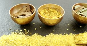 Various spices in bowl with yellow rice 4k. Close-up of various spices in bowl with yellow rice 4k stock video