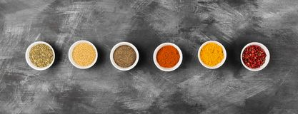 Various spices in bowls on black background. Top view. Food back. Ground Stock Photo