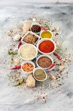 Various spices and cereals in white bowls on a light gray painte Stock Photo