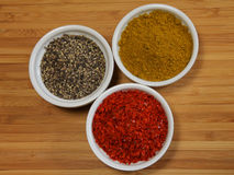 Various spices in dishes Royalty Free Stock Images