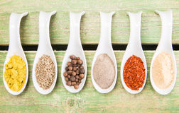 Various spices on green wooden table Stock Photo