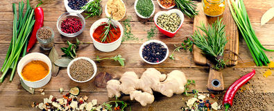 Various spices and herbs on rustic wooden background. Top view Stock Photo