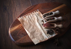 Various spices and herbs on a wooden background. Free space for text. Stock Image