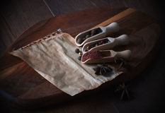 Various spices and herbs on a wooden background. Free space for text. Royalty Free Stock Photos