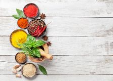 Various spices and herbs. On wooden table. Top view with space for your text royalty free stock image