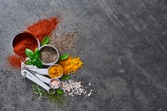 Various spices in measuring cups. royalty free stock photography